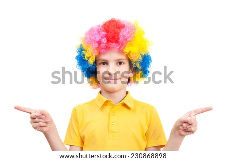 Nice boy in clown dress pointing at sides, isolated on white background  - stock photo
