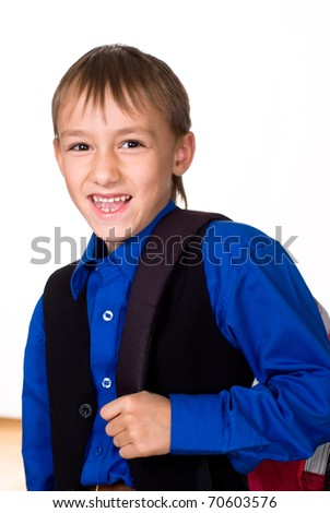 nice boy in the blue shirt on a white background