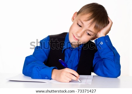 nice boy in the blue shirt on a white background - stock photo