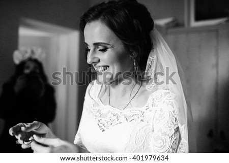 Nice bride is holding a jewelry