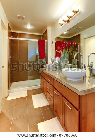 Nice brown modern bathroom with round white sinks. - stock photo