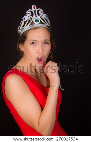 Nice brunette in red singing - stock photo