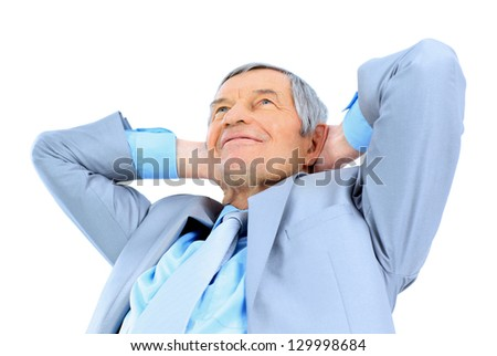 Nice businessman at the age, arms folded behind his head. Isolated on a white background. - stock photo