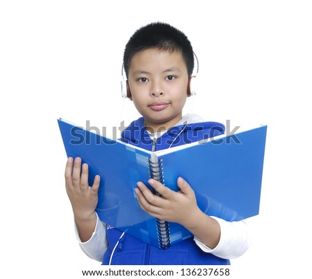 Nice child holding a book listening music - stock photo