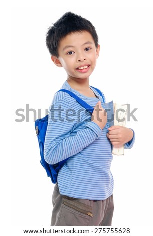 Nice child holding a book with bag - stock photo