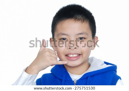 Nice child making a call me gesture - stock photo