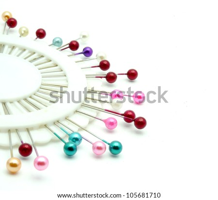 nice colorful pins isolated on a white background - stock photo