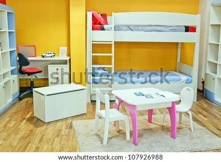 Nice colorful room full decorated with brand new furniture for baby and child - stock photo