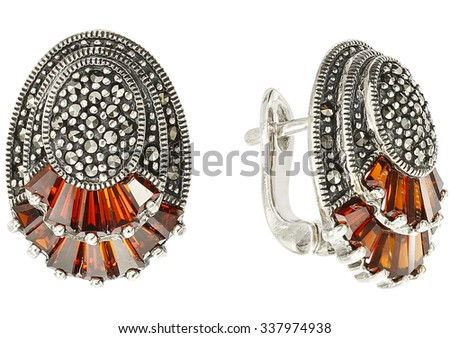 Nice coloured earrings on white - stock photo