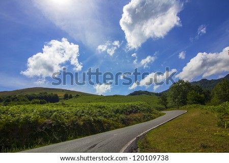 nice country road with blue sky and white clouds background - stock photo