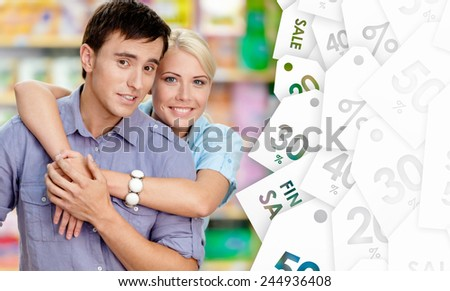 Nice couple in the shop. Concept of happy relationship and affection - stock photo