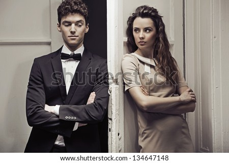 Nice couple next to the door - stock photo