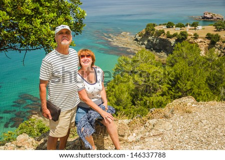 Nice couple of elderly people with sea on background