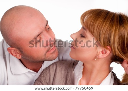 nice couple posing on a white background