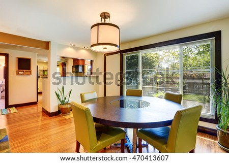 Nice dining area with round table and green chairs. Northwest , USA