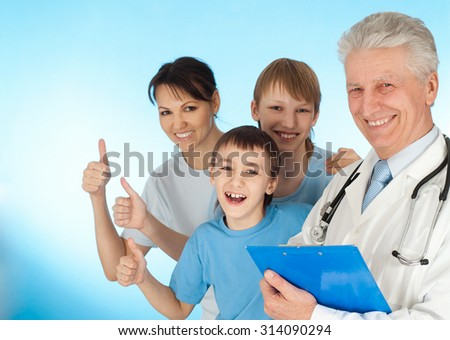 Nice doctor in a white coat with a stethoscope and patients with thumbs up