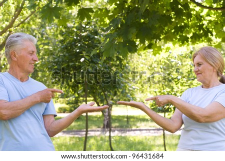 nice elderly couple posing in a park