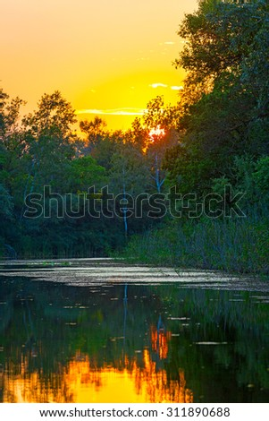 Nice evening scene with sunset on river - stock photo