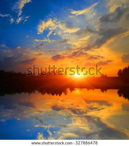 Nice evening sunset scene over lake - stock photo