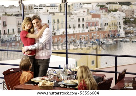 nice family in a sea restaurant - stock photo