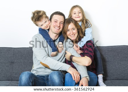 Nice family sit on the livingroom sofa - stock photo