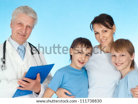 Nice family with children go to the doctor - stock photo