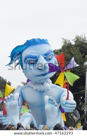 """NICE - FEBRUARY 21: Carnival of Nice on February 21, 2010 in French Riviera. This is the main winter event of the Riviera. 2010 topic is the """"Blue Planet"""". - stock photo"""