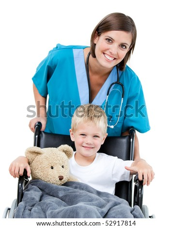 Nice female doctor carrying adorable little boy in the wheelchair at the hospital - stock photo