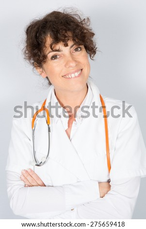 Nice Female doctor or nurse with arms crossed - stock photo