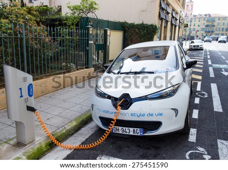 NICE, FRANCE -?? APRIL 11, 2015: A Renault Zoe electric car is connected to a Auto Bleue charging station. Renault Zoe is a five-door supermini electric car produced by the French manufacturer Renault