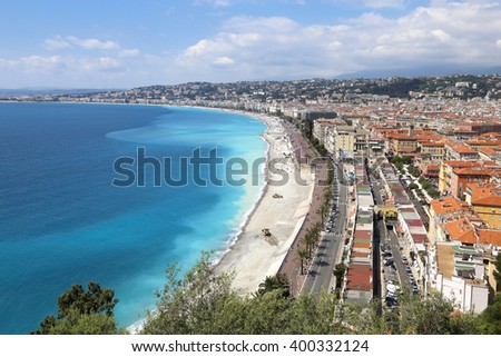 NICE, FRANCE - APRIL 30, 2015: Beach and cityscape of Nice on April 30, 2015 in Nice, France. It is a popular tourist resort on French Riviera. - stock photo