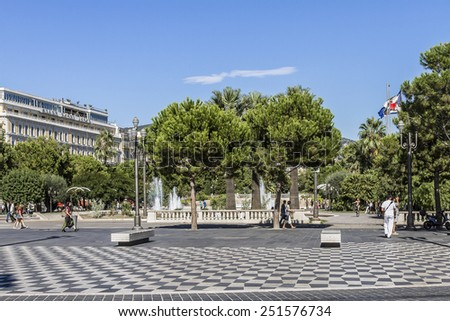 NICE, FRANCE - AUGUST 29, 2012: People hang around Place Massena in Nice. It is Main Square of the city and it is used for concerts and other events which take place in the city. - stock photo