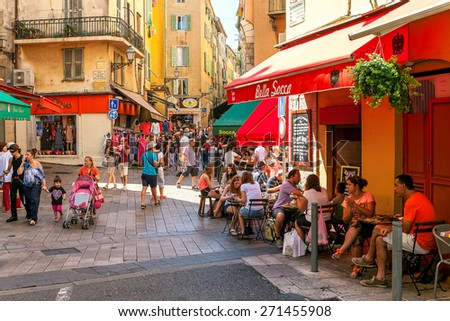 NICE, FRANCE - AUGUST 23, 2014: People in Old City of Nice - fifth most populous, second-largest French city on Mediterranean coast and one of the most visited with 4 million tourists every year. - stock photo