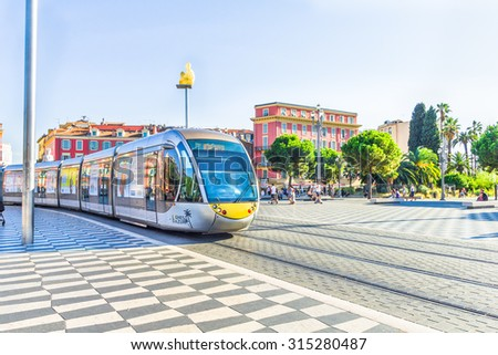 NICE, FRANCE - AUGUST 21: Tourists walking in the Place Massena, on August 21, 2015 in Nice, France. The place is the most famous of the city because of its beauty, shopping options and the carnival.