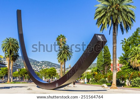 NICE, FRANCE - AUGUST 29, 2012: View of Arc de 115.5 Degrees by Bernar Venet (1988), located in Albert I Gardens next to famous Massena Place. Alpes Maritimes, Provence, Cote d'Azur, French Riviera.