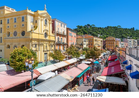 NICE, FRANCE - AUGUST 23, 2014: View of Cours Saleya - large pedestrian area famous for its flower, vegetable, spice and fish markets is one of the most popular places in Nice. - stock photo