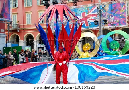 NICE, FRANCE - FEBRUARY 21: Carnival of Nice, France. This is the main winter event of the Riviera. Young man dressed in fantastic colorful costume with English flags. Nice, France - Feb 21, 2012 - stock photo