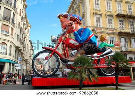 NICE, FRANCE - FEBRUARY 21: Carnival of Nice in French Riviera. This is the main winter event of the Riviera. 2012 theme is the King of Sport. Nice, France - Feb 21, 2012 - stock photo