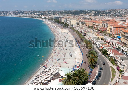 NICE, FRANCE - JULY 9, 2012: The beaches of Nice are in good use during the summertime.