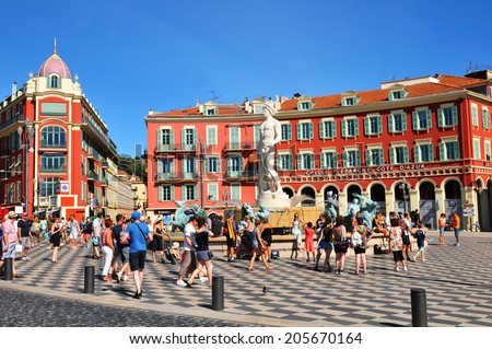 NICE, FRANCE - JULY 29, 2013: Tourists visit Place Massena, major commercial and cultural landmark in Nice. - stock photo