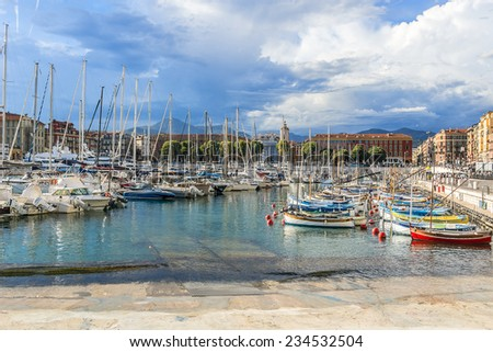 NICE, FRANCE - JULY 11, 2014: View on Port of Nice and yachts, boats, ships. French Riviera - turquoise sea and perfect recreation. - stock photo