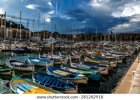 NICE, FRANCE - JULY 11, 2014: View on Port of Nice with yachts, boats, ships. French Riviera - turquoise sea and perfect recreation.