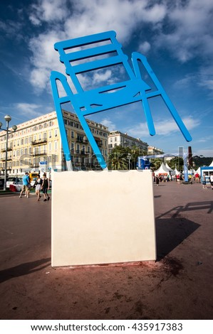 NICE, FRANCE - JUNE 11, 2016: Giant chair along the Promenade des Anglais a sculpture by Sabine Geraudie, Nice, France