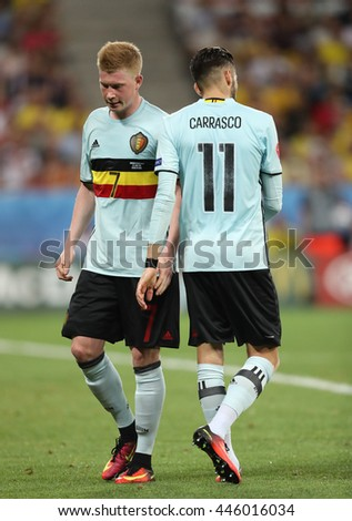 NICE, FRANCE - JUNE 22, 2016: Kevin De Bruyne (L) and Yannick Carrasco of Belgium during UEFA EURO 2016 game against Sweden at Allianz Riviera Stade de Nice, City of Nice, France. Belgium won 1-0 - stock photo