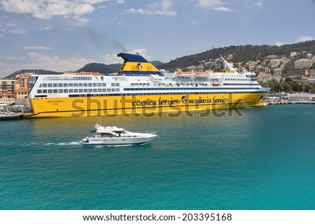 """NICE, France, June 28, 2014: Luxury passenger ship Mega Expres, company """"Corsica Sardinia Ferries', Lympia moored in the harbor in Nice - stock photo"""