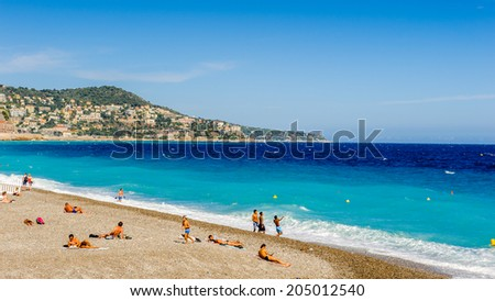 NICE, FRANCE - JUNE 25, 2014: Mediterranea sea coast in Nice, Promenade des Anglais, France. Nice is the capital of the Alpes Maritimes departement