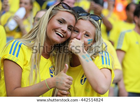 NICE, FRANCE - JUNE 22, 2016: Swedish fans show their support during the UEFA EURO 2016 game Sweden v Belgium at Allianz Riviera Stade de Nice, Nice, France. Belgium won 1-0 - stock photo