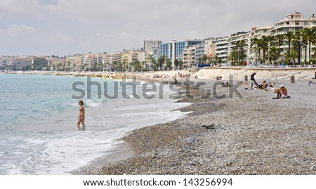 NICE, FRANCE - JUNE 3: the pebble beach on June 3, 2013 in Nice, France. Nice is a popular Mediterranean tourist destination, attracting 4 million visitors each year.