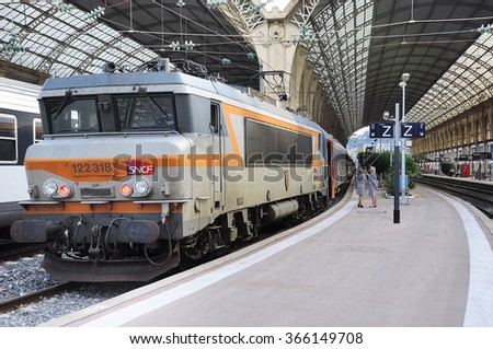 "Nice, France - May 26, 2012: Passenger international train ""Nice-Moscow"" is ready to depart at evening time. Train Nice-Moscow goes one time per week. - stock photo"