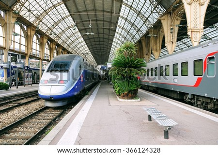 Nice, France - May 26, 2012: Passenger international train Nice-Moscow stands by the high-speed TGV train. Train Nice-Moscow goes one time per week. - stock photo